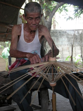 A very experienced umbrella maker, Chiang Mai.