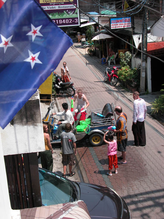Folks from the Rabbit Hole preparing their tuktuk for yet another round... The New Zealand flag waves proudly in the foreground.