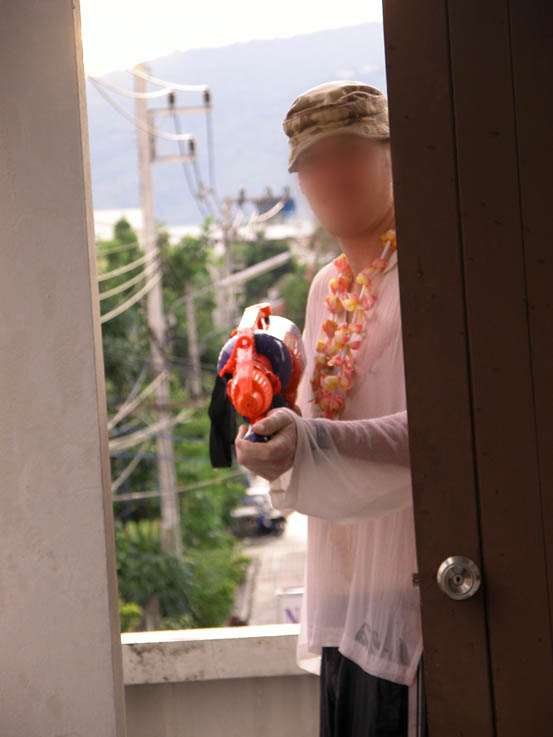 Neighbour patrolling the verandah. (Face blurred for Ninja capabilities)