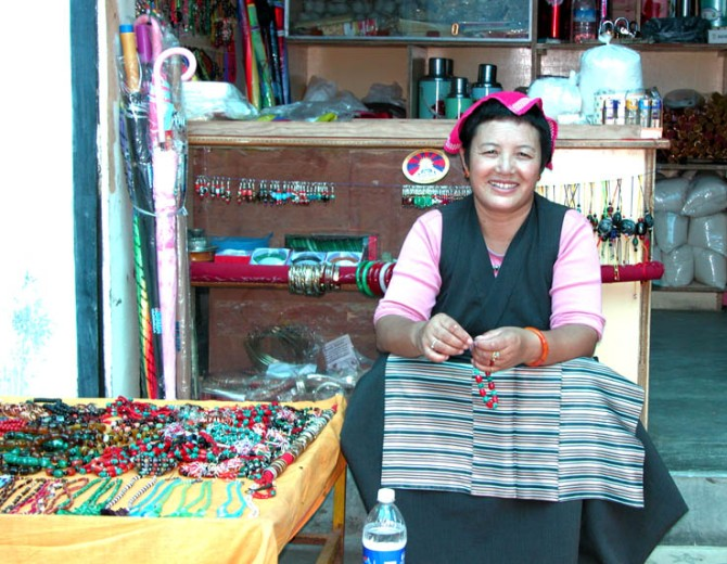 A local Tibetan woman in traditional apron poses for me. Rewalsar, India.