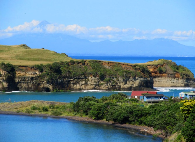 Coast around the 'Three Sisters' region, West Coast, New Zealand. Guest appearance by Mount Taranaki in the background.