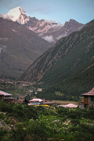 The village of Chitkul, below the Kinnaur Kailash mountain range, Himalayas. Over that snowy peak is Tibet.