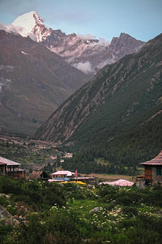 The village of Chitkul, below the Kinnaur Kailash mountain range, Himalayas. Over that snowy peak is Tibet.