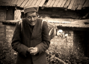 Man with a basket of... something. Chitkul, Himalayas.