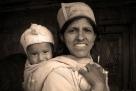 Proud grandma with her grandchild. Chitkul, Himalayas.