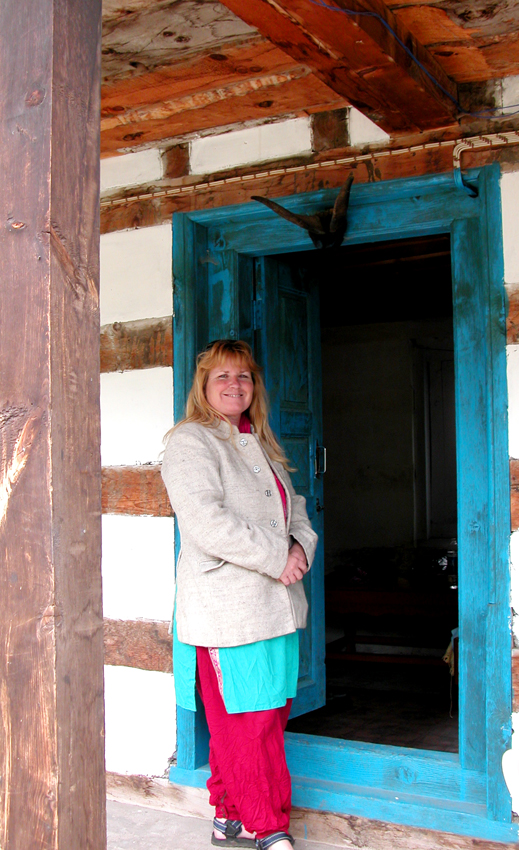 Me at the goatshorn-topped entrance of our room, Chitkul.