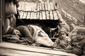 Grandma takes a nap - on the roof, with the babies. Chitkul, Himalayas.