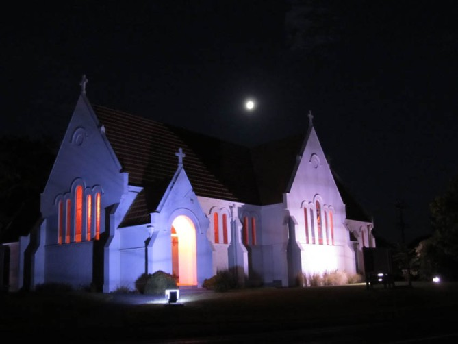 Full moon over a church, Inglewood, Taranaki, North Island.