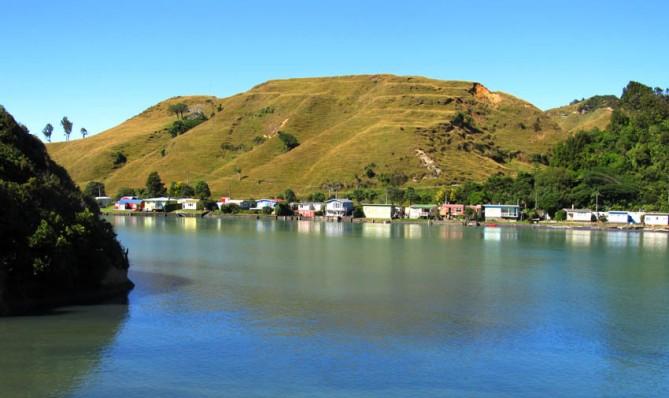 Little Kiwi baches, West Coast, North Island, New Zealand.