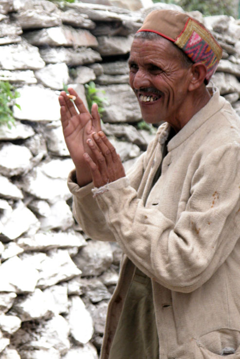 A villager gives thanks for something he just received from a random stranger. Bharmour, Himalayas.