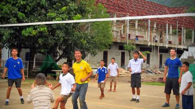 A very serious game of volleyball gets started at the school - kids versus ENP folks.