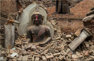 A Buddha statue surrounded by rubble in the Nepal 2015 earthquake. Picture by Al Jazeera English